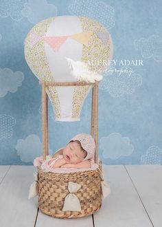 Tiny Explorer Hot Air Balloon. Perfectly sized for newborns! Use this prop indoors or outdoors...the possibilities are endless with a bit of imagination! The Tiny Explorer hot air balloon comes fully assembled, just take it out of the box and photograph!
