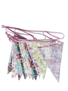 English Rose Party Bunting.  Weddings, fetes and garden, tea or birthday parties get a touch of English country charm with our pretty English Rose party bunting. Each string of English Rose party bunting measures 800cm and sports 15 patterned pennants in a combination of classic chintz designs, including fresh pink roses, fresh springtime sprigs in green and delicate lilac blossoms, all printed on crisp cotton. Total length 800 cm x H 32 cm (per pennant) Machine washable at 30°.