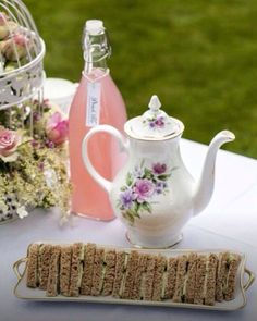 For a summer outdoor wedding a beautiful tea set with lemonade and mini sandwiches will make you the talk of the town!