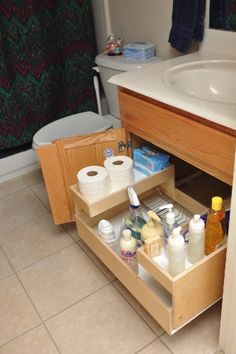 LOVE a pull-out drawer for under the sink.  It's like a black hole under there! keeping it organized!