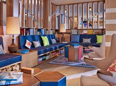 """The  tricked-out lobby has games, books, and magazines, colorful plush  loveseats and a cool vibe ideal for kicking back after a day on the  slopes. The upstairs """"Arcave"""" fills with families in the early evenings thanks to its ping pong and pool tables, pinball games, and air hockey."""
