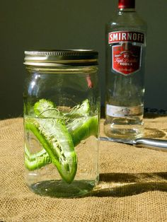 """Jalapeño Infused Vodka www.tattooedmartha.com""  -  I made this with 16x the number of jalapeños.. It's delicious, but you have to water it down a bit with regular vodka"