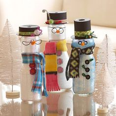 crafts  Snowman Jars- Re purpose old jars to make cute snowmen. Fill a clean jelly jar with Epsom salt. Fit a smaller jar (baby food jars work) to the top of the jelly jar, hot gluing in place. Paint the outsides with glitter glue;let dry. Make a hat from one end of a ribbon spool by painting it black. Accessorize the snowman with buttons,wire glasses,a fleece scarf, and bright ribbon