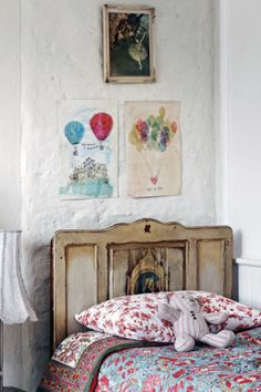 Sweet William drwaings Touch The Sky and Love Is Free, and a Degas ballet print hang above the bed. Country Style, photography Sharyn Cairns.