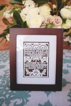 Papel Picado invitation in white, framed for actual wedding day. photo by Stacey Sodolak of SMS Photography: http://www.smsphotographyblog.com
