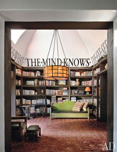 """Designer Stephen Shadley and actress Diane Keaton, who has a passion for restoring old California homes, turned the double-height entrance hall of her Spanish Colonial Revival house in Beverly Hills into an entrance library, filling it with pots and other artifacts as well as books devoted to the visual arts. """"The library sets the mood,"""" explains Shadley. """"It's a distillation of everything that goes on in the house."""""""