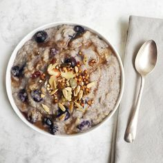 AUTUMNAL BREAKFAST of blueberry and apple quinoa porridge made with @rudehealth new cashew mylk with sprinkling of @louolas quinola @wabbitpie homemade buckwheat muesli and @punchfoods maca caramel superseeds. Perfect for a busy grey day when you don't have much time. Loving the new cashew milk - quite creamy. I did drizzle with a little @oliveology raw vanilla fir honey but leave out for #vegan breakfast - the grated apple gives porridge the sweetness. #plantpower #healthyeating #glutenfree…