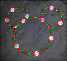 Make Your Own Mickey Mouse Icon Bead Ornament by Guest Blogger Amy Anderson Supplies: 20 – 10 mm Faceted Green Beads 31 – 8 mm Faceted Red Beads 10 – 10 mm Faceted Clear Beads 20 Gauge Wire Mickey Mouse Head Template  Instructions: Template Step 1 – Bend wire following a Mickey Mouse head … Continue reading »