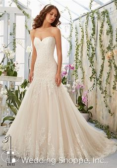 A modern lace fit and flare wedding dress.