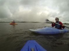 Kayaking on the Weir Wood Reservoir in Sussex.