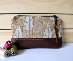 Golden feather pouch.