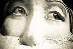This sand sculpture in Cape Canaveral, Florida has incredibly realistic eye detail!  #sandcastle #travel #sandsculpture