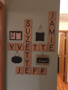 "Scrabble wall. 4x4"" balsa wood. Stained gray. Cricut letters Library font covered with poly."