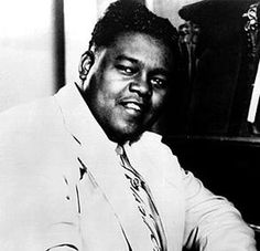 "Fats Domino ~ 1986 Induction Ceremony Rock and Roll Hall of Fame. Fats Domino Pianist Antoine Dominique ""Fats"" Domino Jr. is an American rhythm and blues and rock and roll pianist and singer-songwriter. Domino released five gold records before 1955. Wikipedia Born: February 26, 1928 New Orleans, LA Full name: Antoine Dominique Domino Jr. Songs Blueberry Hil, I Want to Walk You Home, Ain't That a Shame"