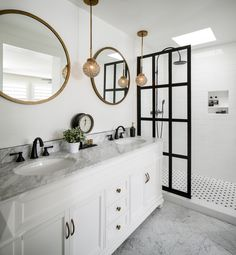 Contrast and classic elements bring drama and timelessness to this master bath.
