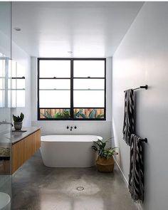White freestanding bath with matte black wall bath spout and lever tap set on mosaic tiled feature shelf wall. Bathroom Concrete Floor, Concrete Floors, Bathroom Flooring, Bathroom Layout, Bathroom Interior Design, Bathroom Ideas, Downstairs Bathroom, Master Bathroom, Bathroom Towel Rails