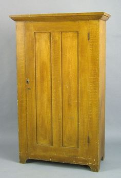 """Sold For $1,100       Pennsylvania painted cupboard, 19th c., retaining its original ochre grain decoration, 61'' h., 33 1/4'' w.      Condition report    Pine and poplar. Case - 14 3/4"""" d. Good condition. No apparent damages or repairs. Please submit request to conditions@pookandpook.com."""
