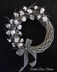 A gorgeous wreath that exudes tons of southern charm. Featuring natural cotton boll stems and faux lavender sprigs on a beautiful, gray willow branch wreath. A perfect wreath for your front door or any room of your home. Wreath measures approximately 24 in diameter and 5 Deep