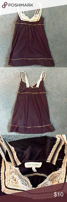 Adorable baby doll tank Black baby doll tank top with off white lace as top detail. Never personally worn and in perfect condition! Stretchy top for those that aren't a small, and cute flow to be comfortable and stylish! Tops Tank Tops
