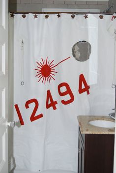 it has portholes!!!!!!  shower curtain :)  made out of old sail