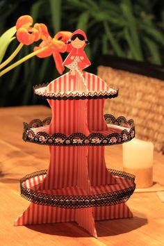 Very easy, and a great party piece. I introduce you to: Cardboard cupcake stand! You will need: 1. Cardboard 2. Spray paint/ fancy paper…