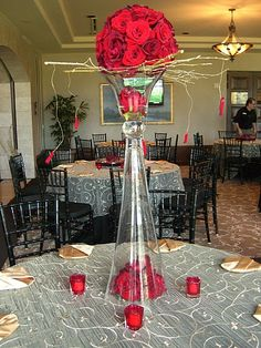 tall table centerpiece. wedding flowers. table arrangement. red roses, gold birch branches, hanging rose petals. http://thebloomingidea.blogspot.com