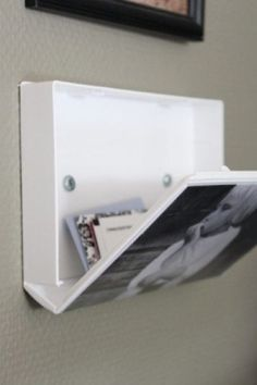 A VHS case screwed into the wall provides unexpected hidden storage. | The 52 Easiest And Quickest DIY Projects Of All Time