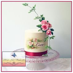 Experimenting with graphics and wafer paper. Vintage image used to create a design, then printed on wafer paper. Burgundy ribbon. Sugar floral spray with pink roses and jasmine vine. Original image from Graphics Fairy website:...