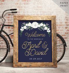 Elegant and dreamy wedding welcome sign with florals in navy and gold