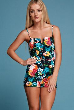 'Maui' Romper - A fun and carefree romper to wear around Maui an explore the natural beauty of the landscape. This simple day to night spaghetti strap romper features a square neckline with a notched V. With a side zipper and fitted bodice, this one piece shows off all your curves! Available in Black. 93% Polyester and 7% Spandex. Made in the USA.