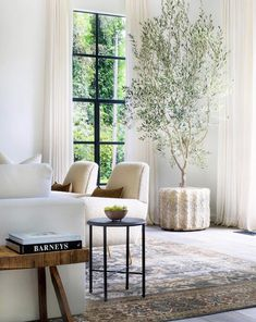 neutral modern living room with This olive tree + window moment deserves all the good emojis. Des neutral modern living room with This olive tree + window moment deserves all the good emojis. Design by Rugs In Living Room, Home And Living, Living Room Designs, Living Room Furniture, Living Room Decor, Modern Living, Rustic Furniture, Room Rugs, Antique Furniture