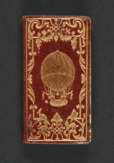 Le calendrier de la cour, 1784. Bookbinding and Book Collecting. Rare Books in the Thomas J. Watson Library. The Metropolitan Museum of Art, New York. Thomas J. Watson Library (b16926389)   Contemporary red morocco, elaborate gilt border with gilt balloons on covers. #books #binding
