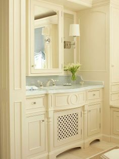 Bathroom Vanity Details  For a more traditional bath, opt for a built-in look with custom cabinetry painted the same color as the walls. Intricate molding, turned legs, lattice doors, and sparkling glass knobs mimic the details of fine furniture; a classic marble countertop adds an elegant finishing touch. A mirrored medicine cabinet mounted on mirrored panels above the sink helps to visually expand the bathroom. BH&G
