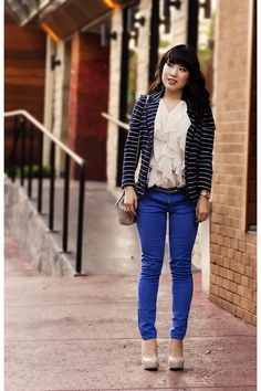 Blue skinny jeans. Colored jeans. Cream ruffle blouse. Nude heels. Black and white striped blazer.