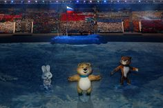 Olympic mascots the Hare, the Polar Bear and the Leopard wave during the Opening Ceremony of the Sochi 2014 Winter Olympics at Fisht Olympic...