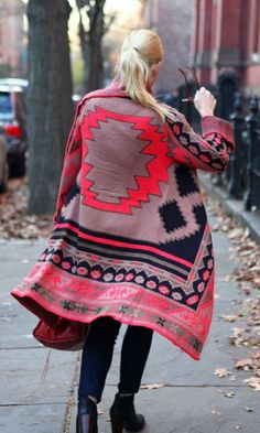I love the colors and patterns of this sweater!
