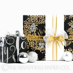 The Wrapping Paper Co. Christmas gift wrap. Noel Black & Christmas Berry Wreath.