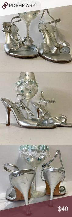 NINA Silver Genuine Leather Silver Bowed Heels NINA Silver Genuine Leather Silver Bowed Heels.  Accent with crystals.  In excellent condition, dust bag included. Nina Shoes Heels