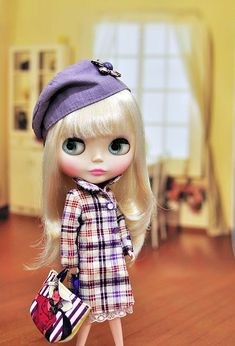 Miss Diva by claireteng206, via Flickr.  She reminds me of Twiggy...all eyes and blond hair.