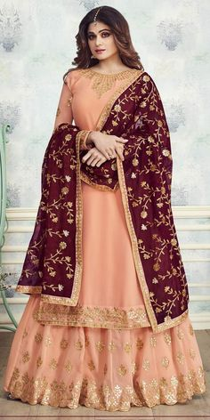 Glorious Light Grey And Peach Georgette Palazzo Suit.This Palazzo Suit has beautified with Heavy Embroidery and matching Net dupatta which gives you Classy Look.