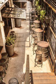Brickhouse   Hong Kong - garage door gate concept with rustic, industrial table…