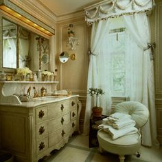 A guest bathroom in a contry house in New Jersey features a vanity designed by Howard Slatkin and made by Frederick P. Victoria.  Curtains made from 19 th century embroidered tablecloths.   Howard Slatkin