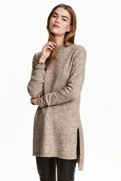 Knitted tunic: Long tunic in a soft knit containing some wool with a turtle neck and slits in the sides. Longer at the back.