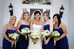 dark blue dresses with white and green bouquets