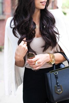 Rich dark brown hair... im in love with her hair length and style need to cut my…