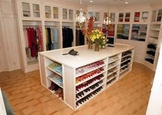 This closet is awesome. I love the shoe island!!