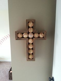 Barnwood Baseball Cross for Jay's bigboy baseball room. Mitered front edge of barnwood to hide fresh cut. See the painted baseball wall behind too!