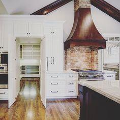 Custom Kitchen with a secret.... Cabinet doors open to a pantry! #atchisonheller #lexington #lexingtonky #custom #construction #kitchen #cabinets #secret #pantry #hardwoodflooring #hood #quartzite #tajmahal #brick #home #craftsmanship #cherrywood #remodel #beautiful by atchisonheller