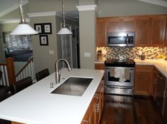Bi-Level Kitchen Renovation Opened up stairs, moved island, tile work, moldings & cabinet re-do!!! Like big pic there too!!