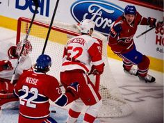 Montreal Canadiens defenceman Jeff Petry, right, celebrates after scoring against Detroit Red Wings goalie Jimmy Howard during NHL action at the Bell Centre in Montreal on Thursday April 9, 2015. Montreal Canadiens right wing Dale Weise and Detroit Red Wings defenceman Jonathan Ericsson look on.